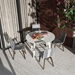 Modloft Amsterdam Round Modern Outdoor Dining Table in White Sand Concrete with White Steel Base - Lifestyle Above View